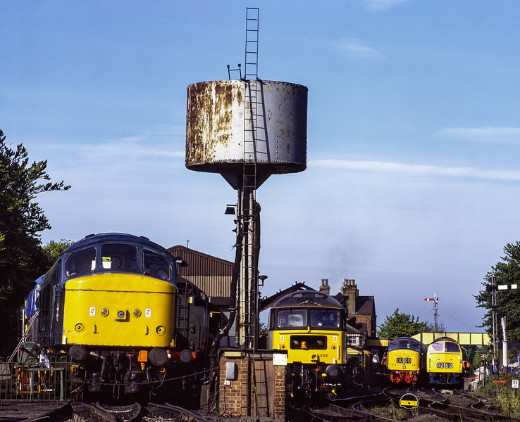 47358, 45112 and D1013 lined up at Ropley, at the start of the third day of the Diesel Gala <br /> on 15th May 2005. 45132 was on static display only. Scanned Transparency.