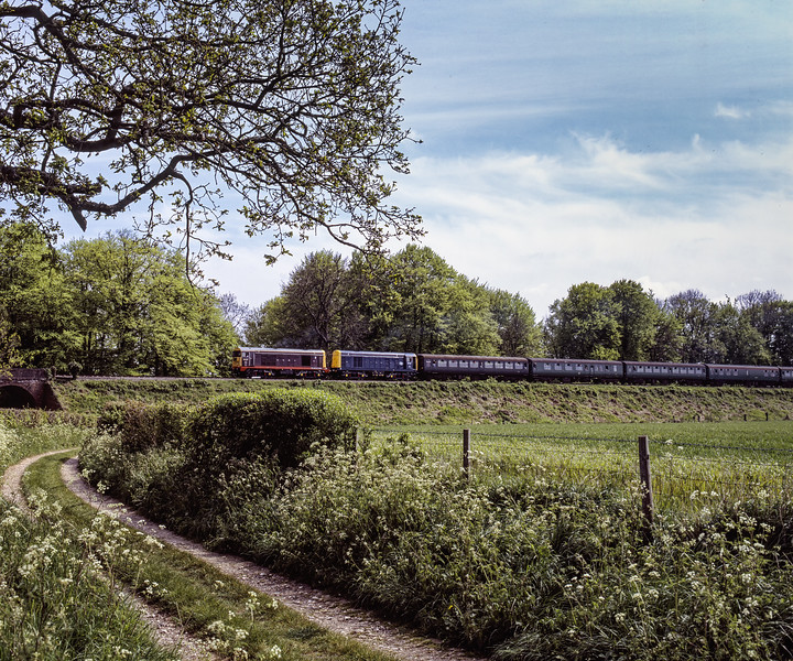 """20227 """"Sir John Betjeman"""" and 20001 at Rookwood Lane with the 14:15 Alresford - Alton, <br /> on 15th May 2005. Scanned Transparency."""