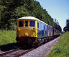 73201 and 73107 approaching Ropley, with the 11:00 Alton - Alresford, on 30th May 2009. Scanned Transparency.