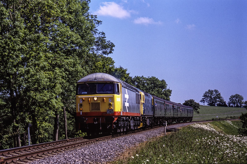 56098 and 33053 on Wanders Curve, with the 10:30 Alton - Alresford, on 31st May 2009. Scanned Transparency.