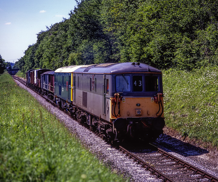 73107 and 73201, climbing away from Ropley, with the 11:50 Alresford - Alton Goods, <br /> on 30th May 2009. Scanned Transparency.