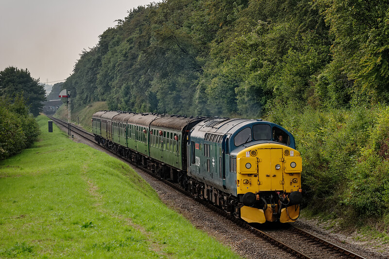 37324 passes Ropley Down Outer Home signal, with the 13:15 Alresford - Alton, <br /> on 6th September 2014.