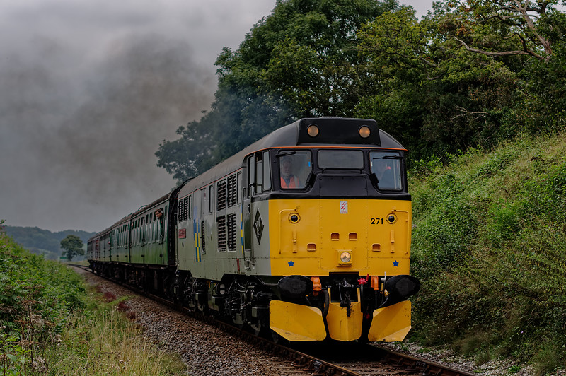 31271 passes Wanders Crossing, with the 12:35 Alresford - Alton, on 5th September 2014.