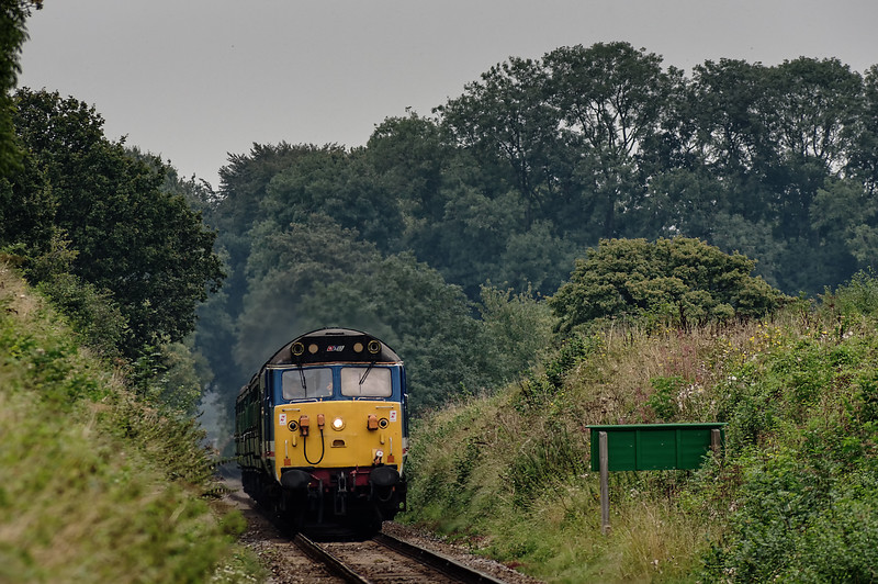 50027 passing Wanders Crossing whistle board, with the 13:00 Alton - Alresford, <br /> on 5th September 2014.