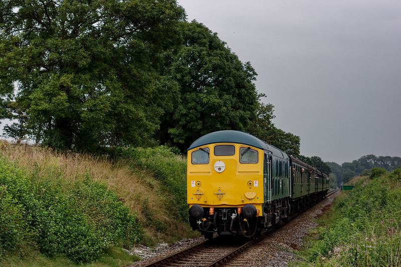 24081 approaching Wanders Crossing, with the 12:20 Alton - Alresford, <br /> on 5th September 2014.