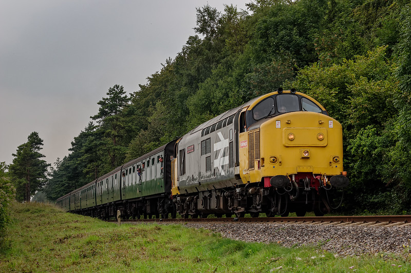 37901 exits the Pine Trees, with the 13:55 Alresford - Alton, on 6th September 2014.