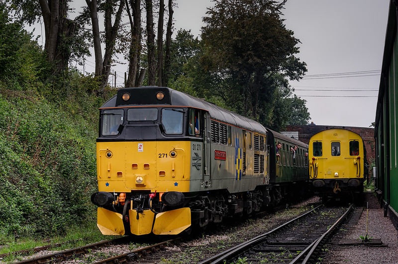 31271 arriving at Ropley, with the 10:20 Alton - Alresford, while 205025 waits in the headshunt. 7th September 2014.
