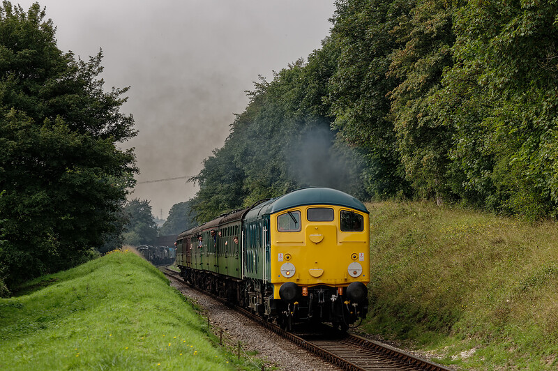 24081 at College Crossing, with the 11:15 Alresford - Alton, on 6th September 2014.