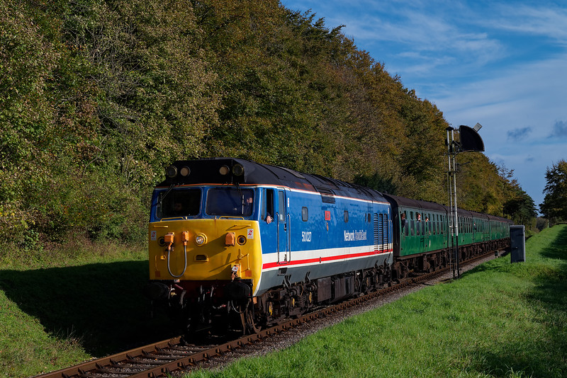 50027 getting away from Ropley Down Outer Home signal, with the 10:10 Alton - Alresford, on 22nd October 2017.