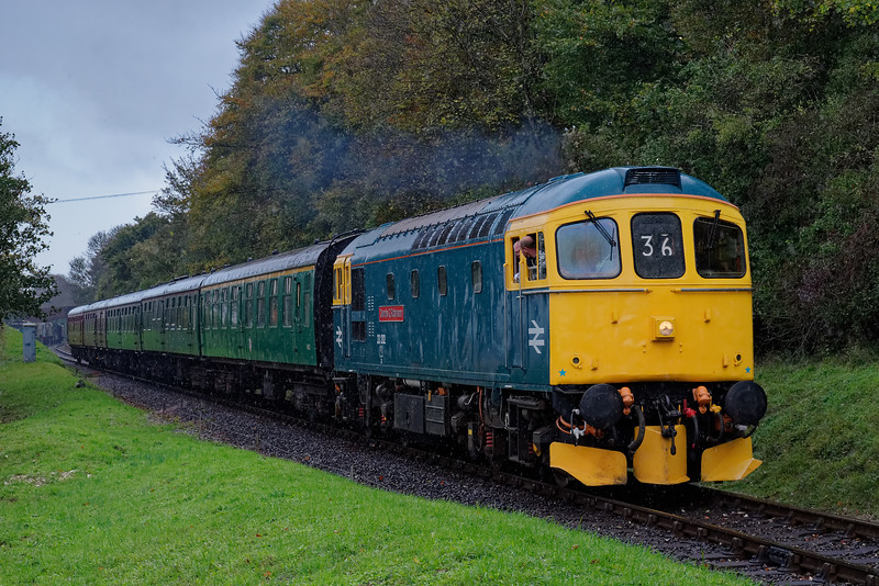33202 at College Crossing, with the 11:45 Alresford - Alton, on 21st October 2017.