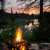 the sun sets and we build a fire at our lean-to...