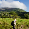 James strolling in the foreground of Arenal volcano