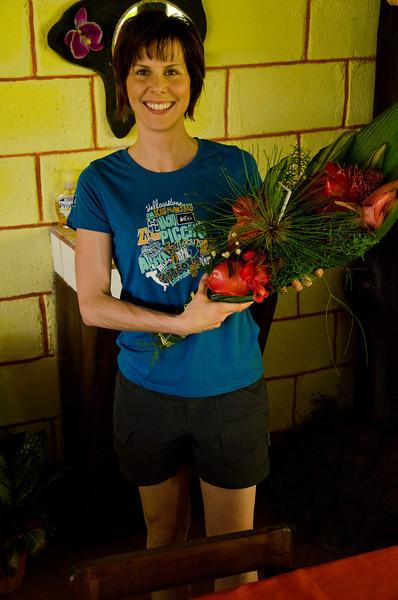 the kids give Jess an beautiful honeymoon bouquet.
