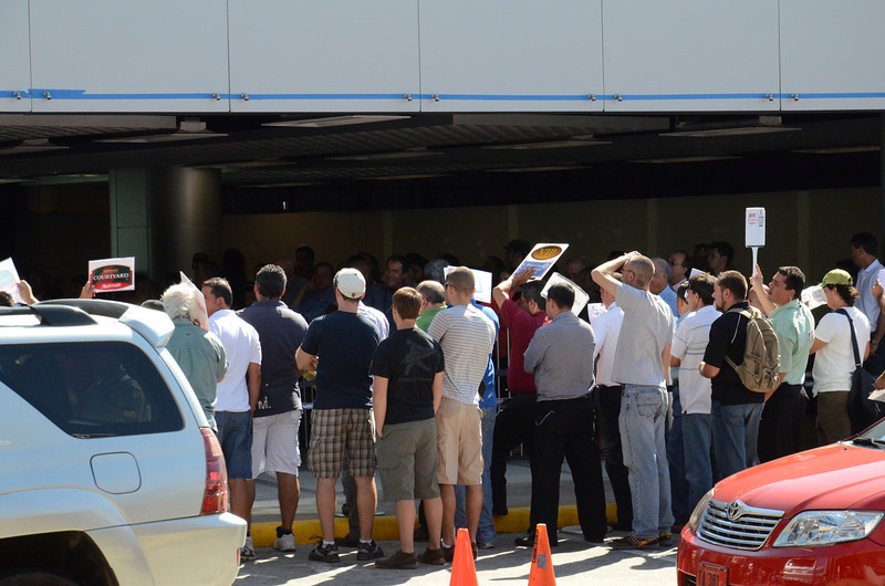 This is the chaos outside the San Jose Int airport. hundreds of taxi drivers fighting for your business.