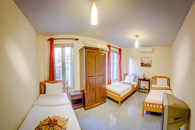 Six bedroom Temple House Villa bedroom with 3 single beds, Kantiang Bay, Ko Lanta