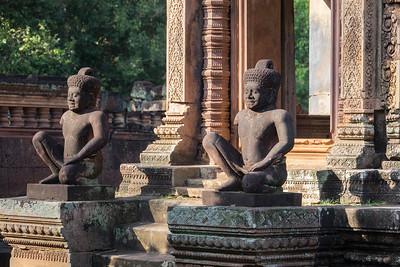 Banteay Srei statues sitting tall