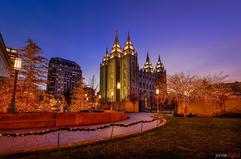 The Salt Lake LDS Temple at christmas time just after sunset with christmas lights