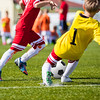 Children Playing Soccer Football Match. Youth Soccer Forward and Goalkeeper Duel