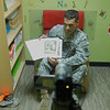 3BCT Soldier reads a bed-time story to his child