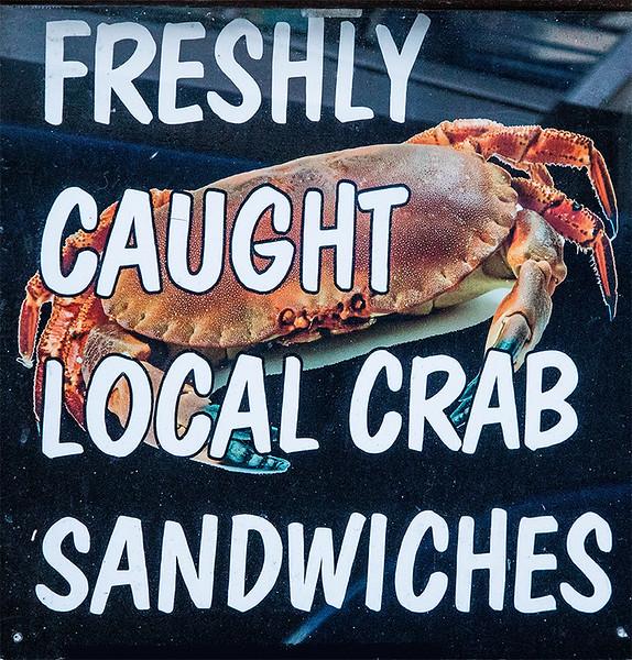 Sign on fish shop window.