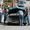 Ben Affleck smokes as they try and fix the car for a scene on Cane Street. SENTINEL & ENTERPRISE/JOHN LOVE
