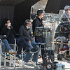 George Clooney looks at some monitors as they film on Boykston Street. SENTINEL & ENTERPRISE/JOHN LOVE