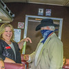 Car host Becky White laughs at the train robber