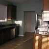 kitchen with door to garage and basement and closets