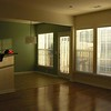 dining room and living room windows with entrance to upper deck