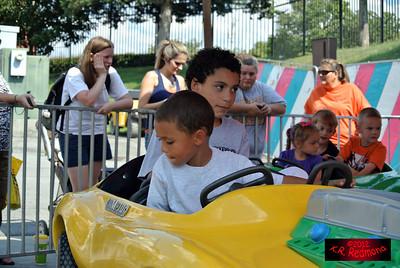 Brazil and Elijah on the Race Car Ride