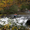 Kayaker and guy and white water canoe on Bald River