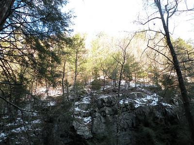 Snowy cliffs opposite Rock Creek Falls