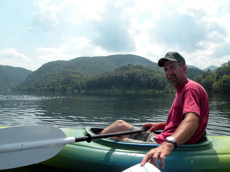 Kenny paddling back across the lake. Whatever was behind that pump house spooked him and he was ready to leave.