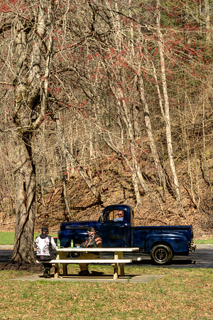 A couple enjoy lunch at a picnic table while chatting with a driver-by at the South Holston Dam Recreation Area in Bristol, TN on Saturday, April 5, 2014. Copyright 2014 Jason Barnette