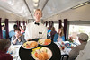 A well-dressed waiter serves sandwiches in the dining car during the Chickamauga Turn at the Tennessee Valley Railroad Museum in Chattanooga, TN on Saturday, July 18, 2015. Copyright 2015 Jason Barnette