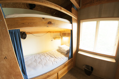 A pair of built-in, cozy bunk beds at The Crash Pad, a locally owned hostel, in Chattanooga, TN on Thursday, July 23, 2015. Copyright 2015 Jason Barnette