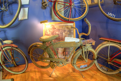 "An old bicycle on display in front of a movie poster for ""The Bicycle Thief"" at the Little Congress Bicycle Museum in Cumberland Gap, TN on Friday, June 12, 2015. Copyright 2015 Jason Barnette"