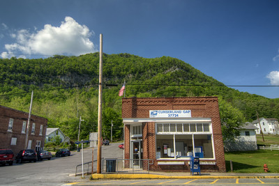 The one-room post office with the looming mountain in the background at Cumberland Gap, TN on Saturday, May 9, 2015. Copyright 2015 Jason Barnette