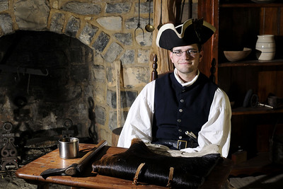 Re-enactor Joseph Gamble portrays a 1780's frontier settler at the recreation of Crockett's birth cabin at Davy Crockett Birthplace State Park in Limestone, TN on Friday, June 6, 2014. Copyright 2014 Jason Barnette