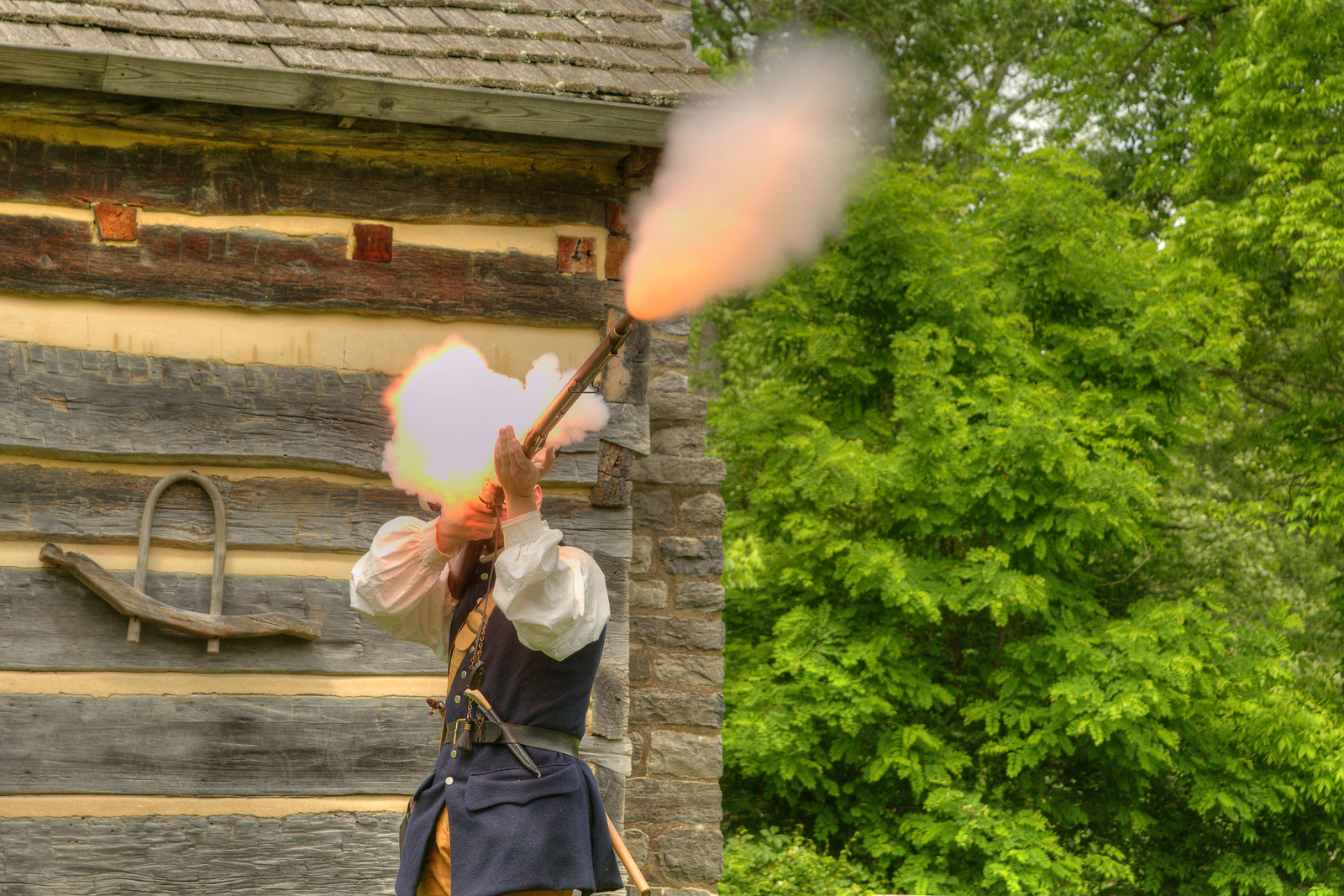 Re-enactor Joseph Gamble, portraying a 1780's frontier settler, fires a flint-lock musket at Davy Crockett Birthplace State Park in Limestone, TN on Friday, June 6, 2014. Copyright 2014 Jason Barnette