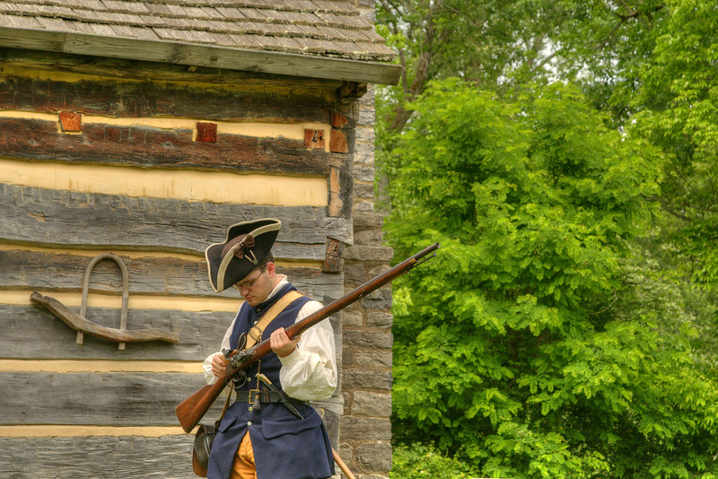 Re-enactor Joseph Gamble, portraying a 1780's frontier settler, prepares to fire a flint-lock musket at Davy Crockett Birthplace State Park in Limestone, TN on Friday, June 6, 2014. Copyright 2014 Jason Barnette