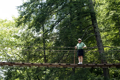 A man walks across the swinging bridge over Cane Creek Cascades at Fall Creek Falls State Park in Spencer, TN on Thursday, July 16, 2015. Copyright 2015 Jason Barnette
