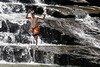 A young boy leaps into the water at the bottom of Cane Creek Cascades at Fall Creek Falls State Park in Spencer, TN on Thursday, July 16, 2015. Copyright 2015 Jason Barnette
