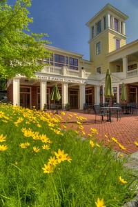 Blooming flowers surround the patio in front of the Mary B. Martin Storytelling Hall at the International Storytelling Center in downtown Jonesborough, TN on Friday, June 6, 2014. Copyright 2014 Jason Barnette