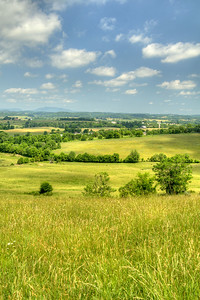 The view of flat lands and distant mountain ranges along Highway 11E in Jonesborough, TN on Friday, June 6, 2014. Copyright 2014 Jason Barnette