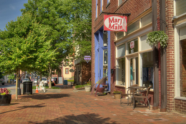 Quite, but beautiful, sidewalks on an early morning in downtown Jonesborough, TN on Friday, June 6, 2014. Copyright 2014 Jason Barnette