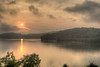 The sun rises over the lake on a foggy morning at the Boone Lake Recreation Area in Kingsport, TN on Saturday, May 31, 2014. Copyright 2014 Jason Barnette