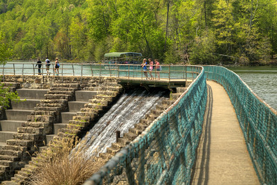 Visitors walk across the dam at the lake at Bays Mountain Park and Planetarium in Kingsport, TN on Saturday, May 2, 2015. Copyright 2015 Jason Barnette