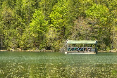The barge moves across the lake during a tour at Bays Mountain Park and Planetarium in Kingsport, TN on Saturday, May 2, 2015. Copyright 2015 Jason Barnette