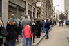 """People line up around the corner, some of them waiting over ninety minutes, for a chance to watch """"It's a Wonderful Life"""" at the historic Tennessee Theatre in Knoxville, TN on Sunday, December 14, 2014. Copyright 2014 Jason Barnette"""
